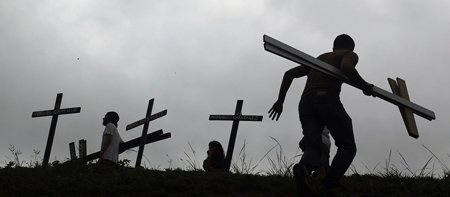 People place crosses, representing people who have died during the most recent opposition protest movement, on the side of the highway during a national sit-in against President Nicolas Maduro, in Caracas, Venezuela. (AP Photo/Fernando Llano)