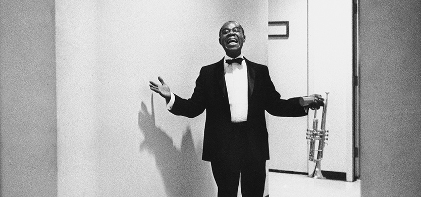 "Louis ""Satchmo"" Armstrong is coming out of a Las Vegas dressing room in September 1970 and announcing to the photographer it was his ""debut."" It was the first time back for Satchmo after an illness. (AP Photo/Eddie Adams)"