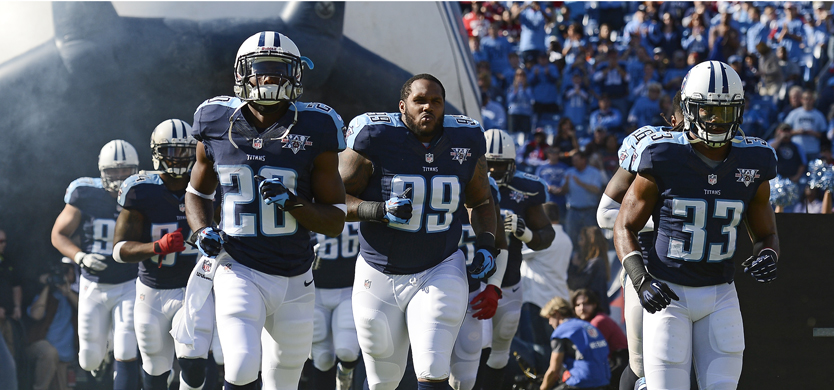 Tennessee Titans running back Chris Johnson (28) blocks Houston Texans safety Bernard Pollard as Titans quarterback Kerry Collins (5) looks for a receiver in the third quarter of an NFL football game on Sunday, Dec. 19, 2010, in Nashville, Tenn. (AP Photo/Joe Howell)