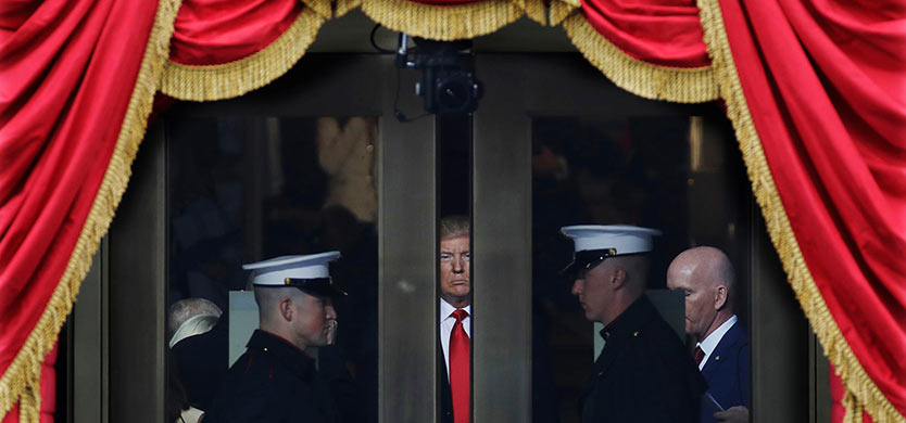 President-elect Donald Trump waits to step out onto the portico for his Presidential Inauguration at the U.S. Capitol in Washington, on Jan. 20, 2017. (AP Photo/Patrick Semansky)  Use Information This content is intended for editorial use only.