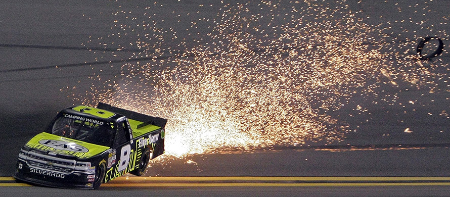 Sparks fly from John Hunter Nemechek's truck after a flat tire during a NASCAR truck series auto race at Daytona International Speedway in Daytona Beach, Fla. (AP Photo/Darryl Graham)