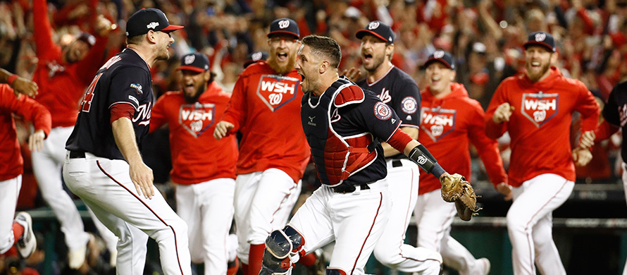 Washington Nationals' Yan Gomes and Daniel Hudson celebrate after Game 4 of the baseball National League Championship Series Tuesday, Oct. 15, 2019, in Washington. (AP Photo/Patrick Semansky)