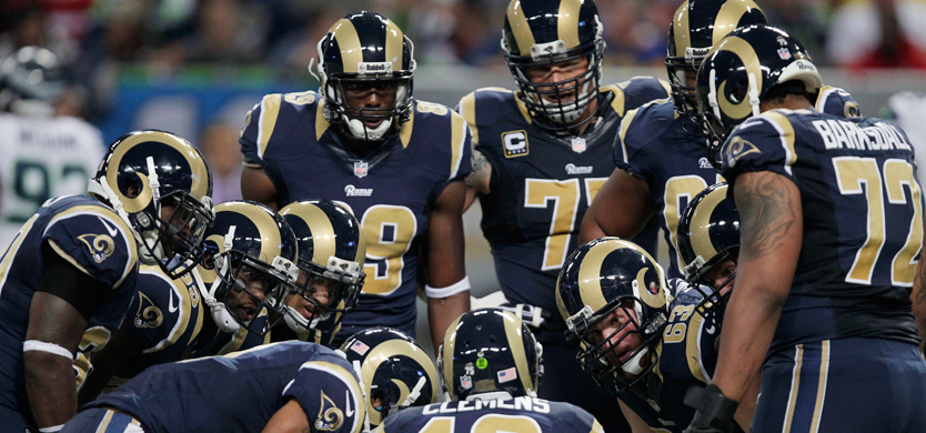 St. Louis Rams defensive end Chris Long (91) celebrates after sacking New York Jets quarterback Mark Sanchez for a 3-yard loss during the second quarter of an NFL football game, Sunday, Nov. 18, 2012, in St. Louis. (AP Photo/L.G. Patterson)